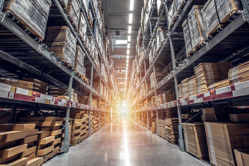 warehouse interior with shelves, pallets and boxes, Rows of shelves with goods boxes in modern industry warehouse store at factor royalty free stock images