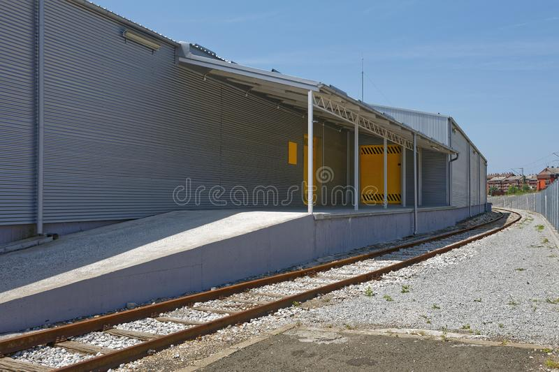Warehouse Loading Dock. Loading Dock With Railway Track at Distribution Warehouse royalty free stock photography