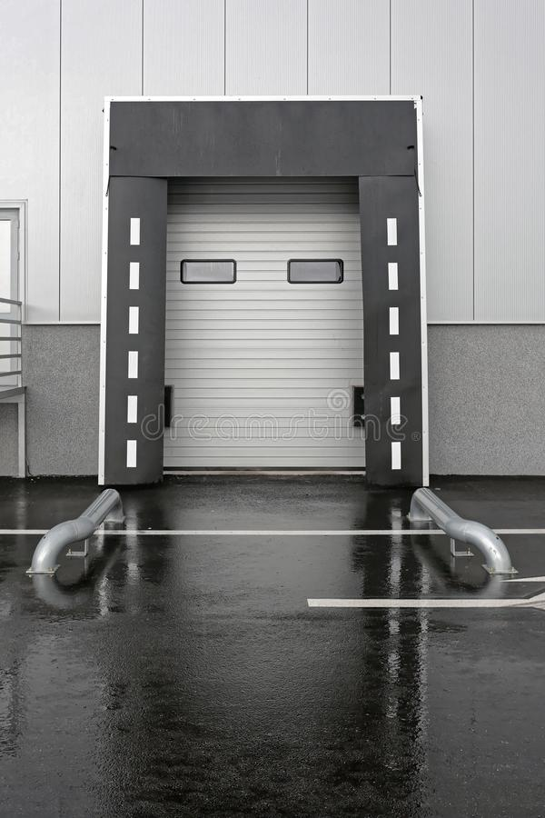 Warehouse Loading Door. Loading Dock Door for Trucks at Distribution Warehouse royalty free stock photo