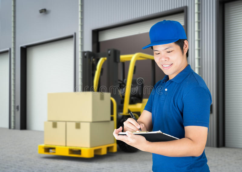 Warehouse man working. Asian delivery man or warehouse man working royalty free stock photos