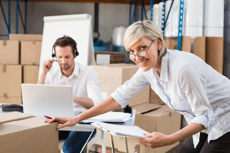 Warehouse manager checking her inventory stock photography