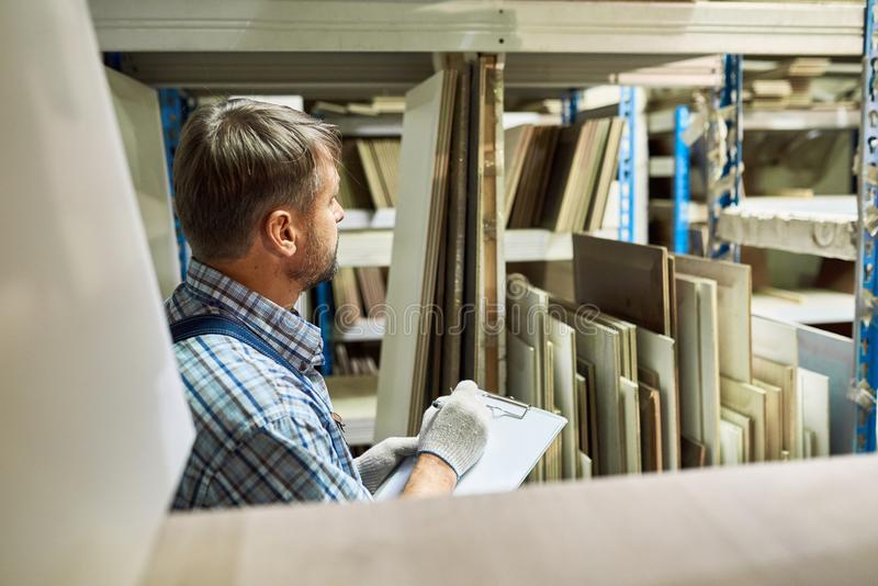 Warehouse Manager Doing Inventory stock image