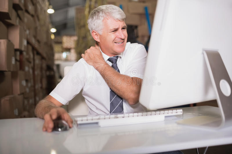 Warehouse manager using computer. At warehouse royalty free stock photos