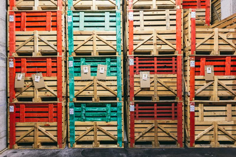 Many wine boxes in the warehouse. Warehouse with many boxes of wine, storage of wine, wine business, retail and wholesale wine sale stock photos