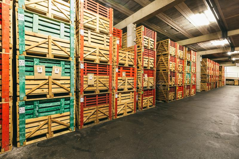 Warehouse with boxes of wine. Warehouse with many boxes of wine, storage of wine, wine business, retail and wholesale wine sale stock images