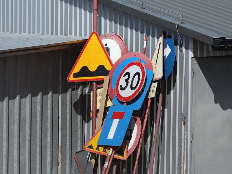 Warehouse of old worn road signs. Rusty metalol. Regulation and rules of the road. Safety of public and personal stock image