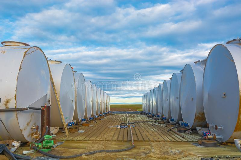 Warehouse of petroleum products in cylindrical tanks. Horizontally located cylindrical tanks with oil products and fuel for equipment. Installed in two rows stock photos