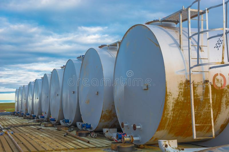 Warehouse of petroleum products in cylindrical tanks. Horizontally located cylindrical tanks with oil products and fuel for equipment. Installed in one row stock image