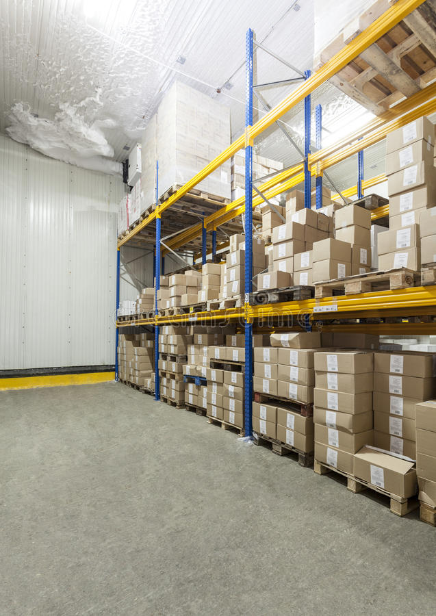 Warehouse. With products, boxes in a cold store stock images