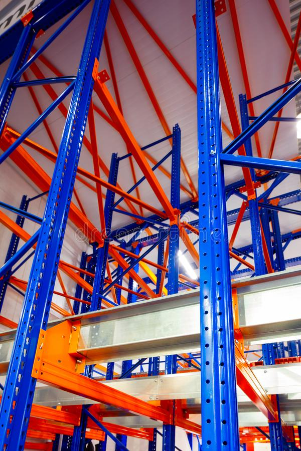 Warehouse racks metal dismountable constructions, modern warehouse technology background concept, vertical orientation, close-up w. Ith perspective, view from stock images