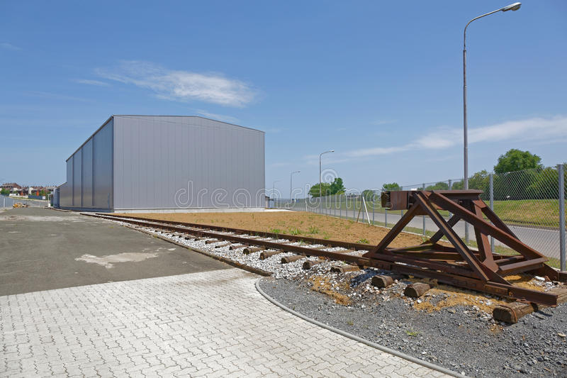 Warehouse Rail. Distribution Warehouse Building With Rail Road Tracks stock image
