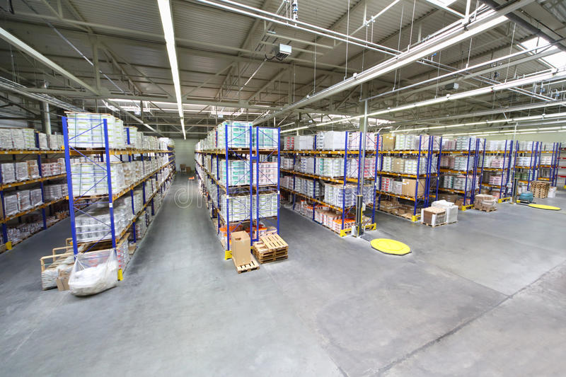 Warehouse with rows of shelves at Caparol factory. MOSCOW - JUNE 5: Warehouse with rows of shelves at Caparol factory on June 5, 2012 in Moscow, Russia. Caparol royalty free stock photography