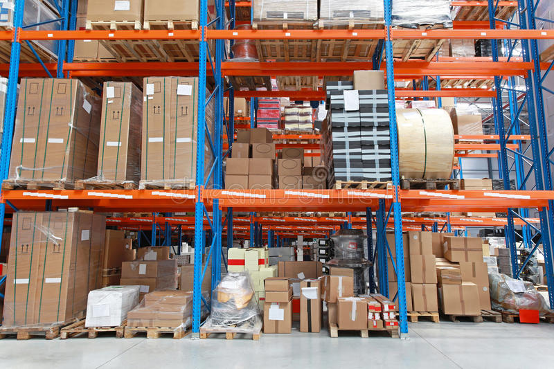 Warehouse shelf. Shelving system with goods in distribution warehouse stock images