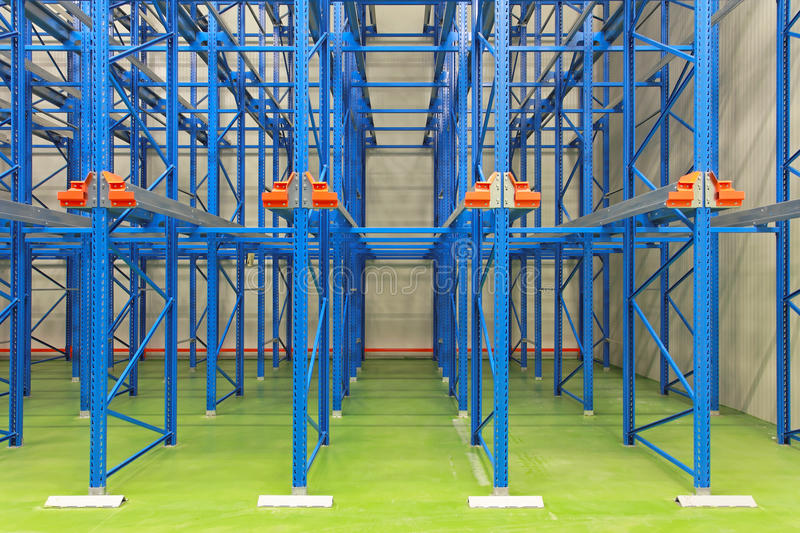 Warehouse shelves. Blue shelving system in distribution warehouse royalty free stock photo