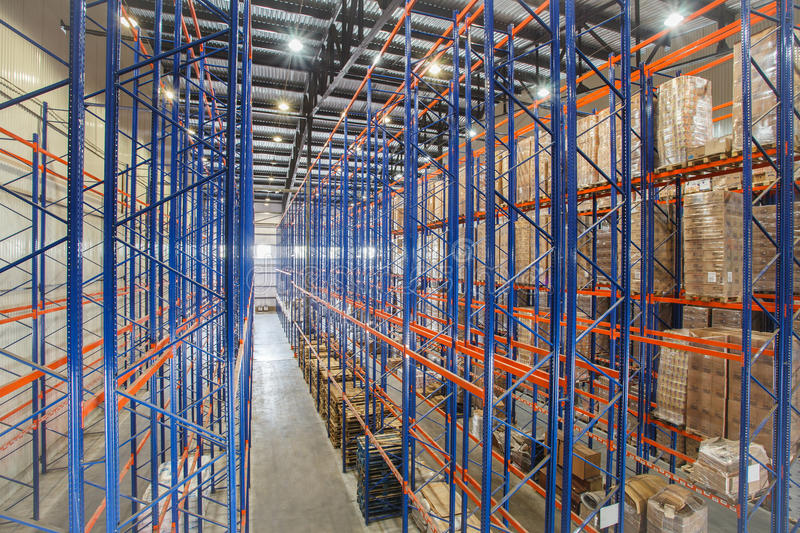 Warehouse shelves. The warehouse complex for the storage of consumer goods stock image