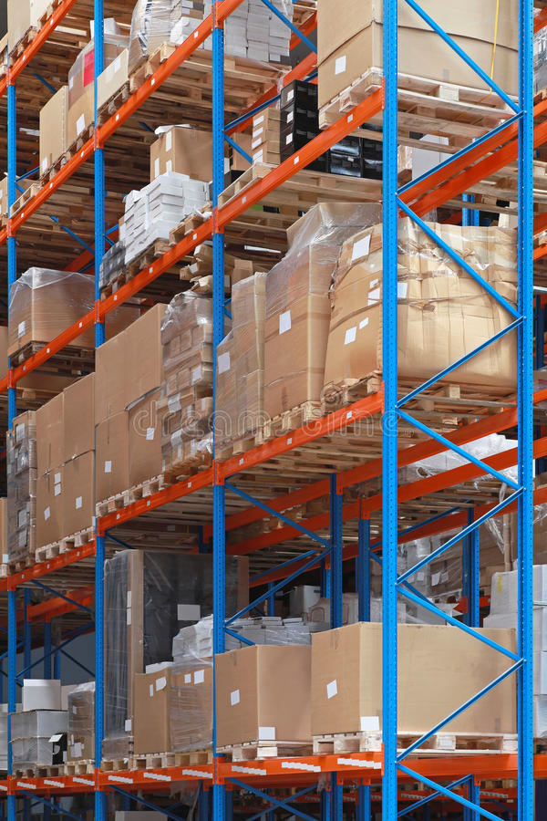 Warehouse. Shelving System With Goods in Distribution Warehouse stock images