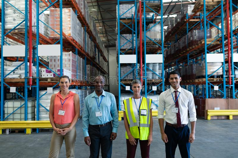 Warehouse staffs standing together in warehouse. Portrait of confident diverse warehouse staffs standing together in warehouse. This is a freight transportation stock photos