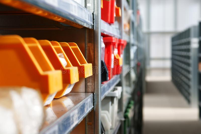 Warehouse Storage Bins and Racks. Storage bins and racks in a modern industrial warehouse shot with shallow focus royalty free stock photos