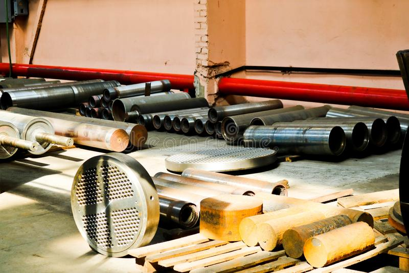 Warehouse, storage of iron rollers, pipes, spare parts for heat exchangers, metal blanks, petrochemical equipment royalty free stock images