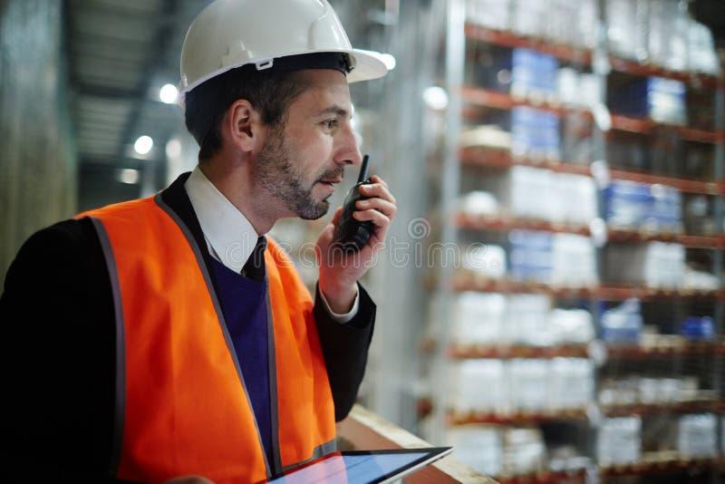 Warehouse Supervisor Managing Work Operations royalty free stock images