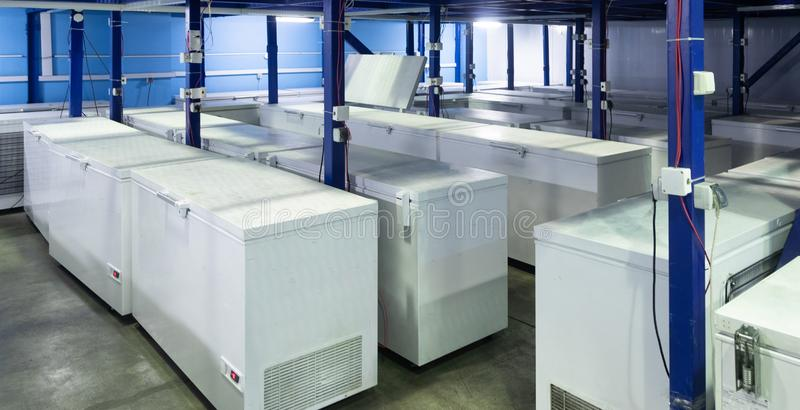 Warehouse with white refrigerators royalty free stock image