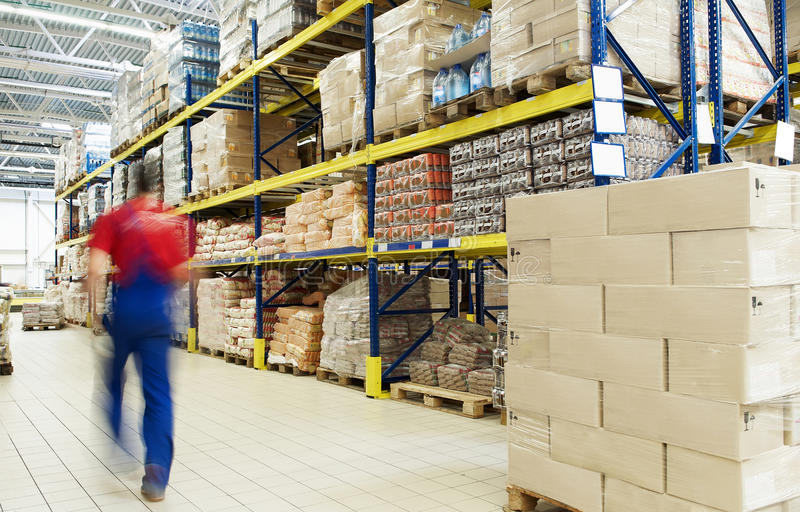 Warehouse and worker royalty free stock photos