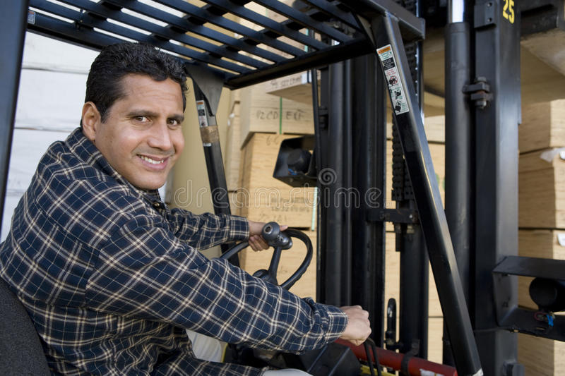 Warehouse Worker Driving Forklift stock photography