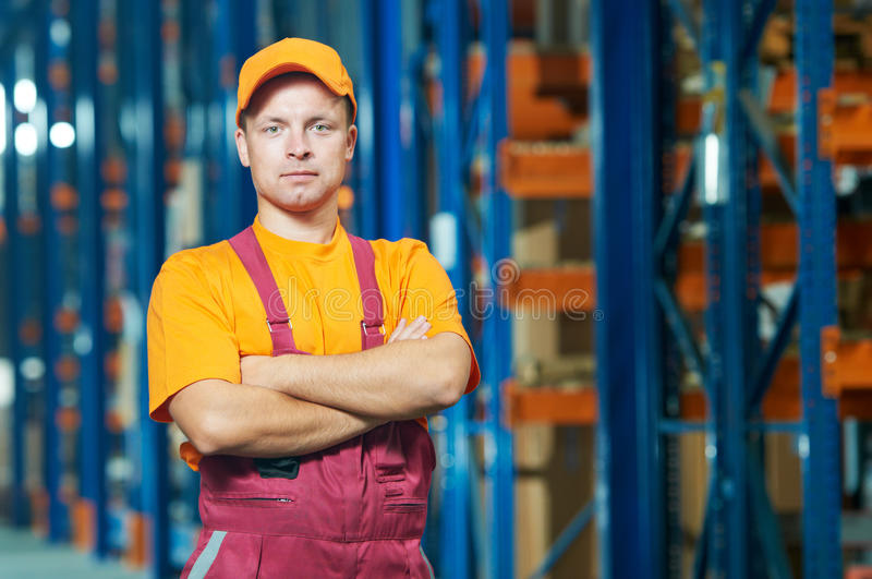 Warehouse worker in front storehouse royalty free stock image