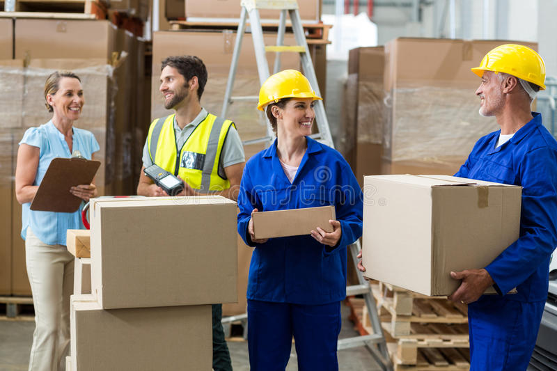Warehouse worker interacting with each other stock images