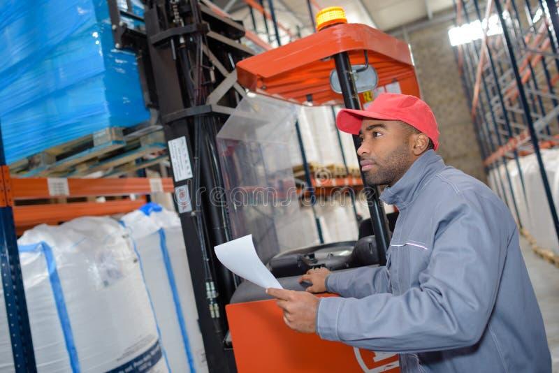 Warehouse worker picking order stock photo