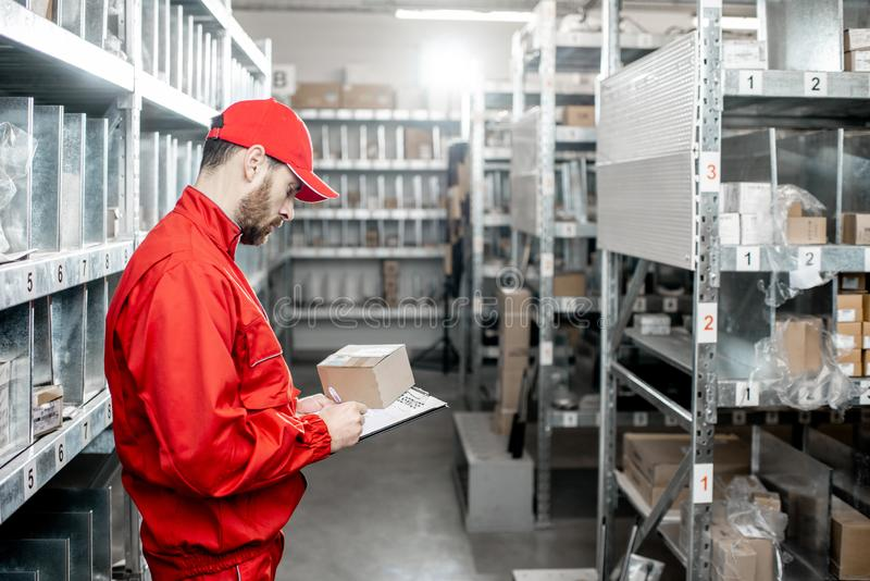 Warehouse worker with clipboard in the storage royalty free stock photos