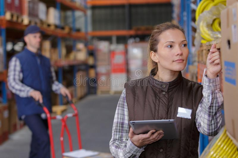 Warehouse worker scanning box in warehouse stock photo