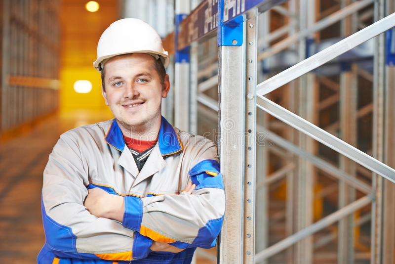 Warehouse worker in storehouse royalty free stock photography