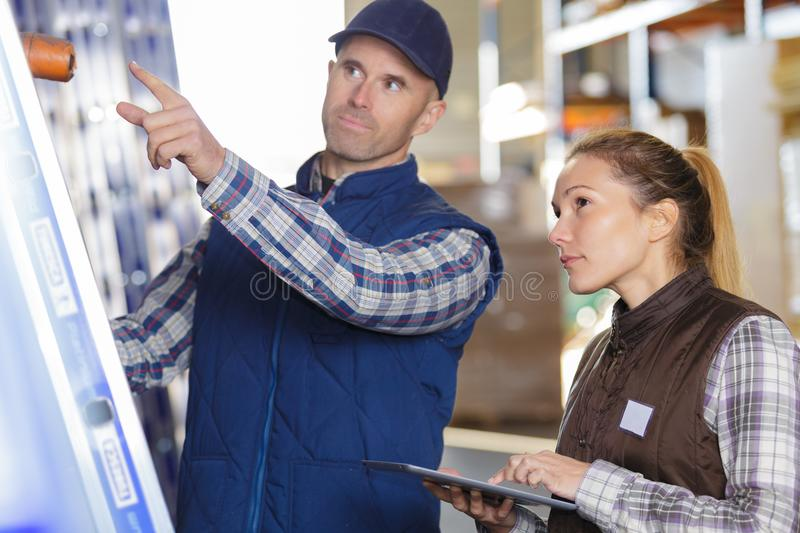 Warehouse workers in warehouse royalty free stock images