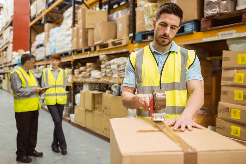 Warehouse workers preparing a shipment stock image