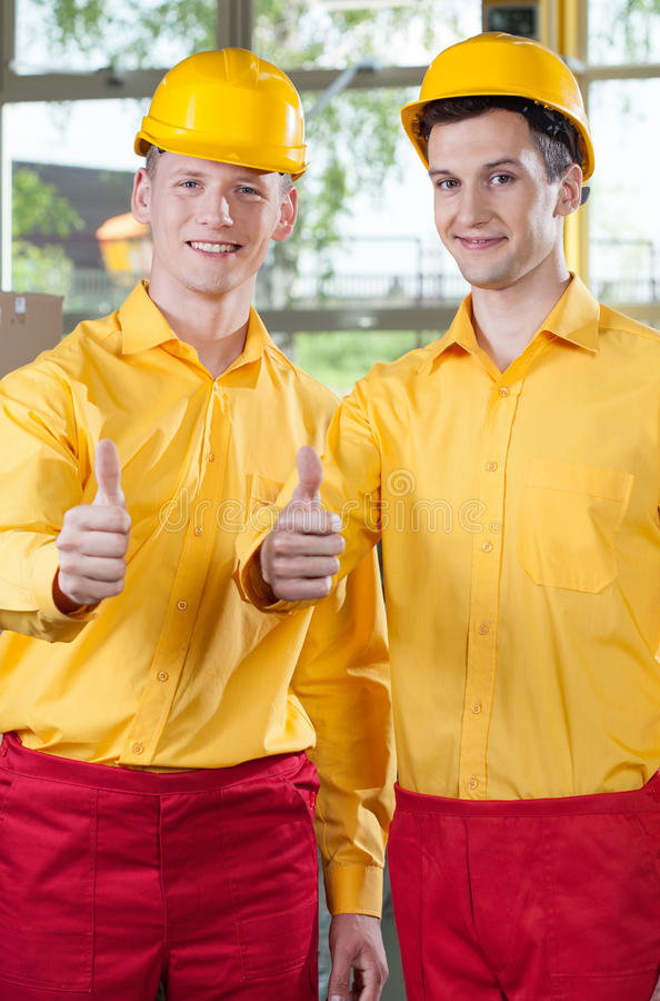 Warehouse workers showing thumbs up sign stock image