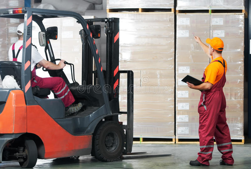 Warehouse works (forklift stock photo