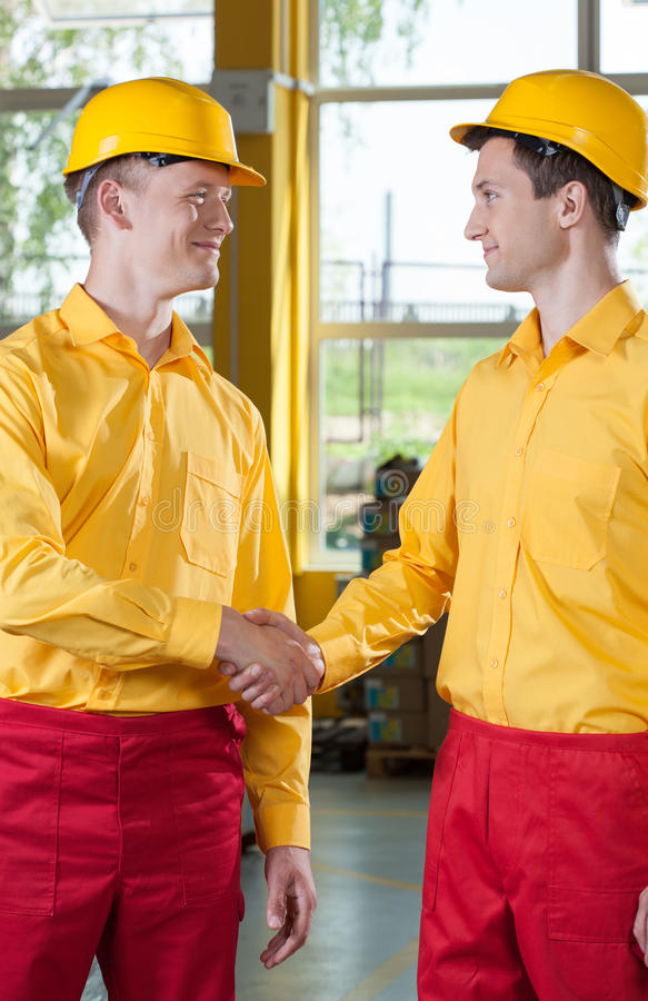 Warehouseman's welcome in a factory. Vertical view of warehouseman's welcome in a factory stock images