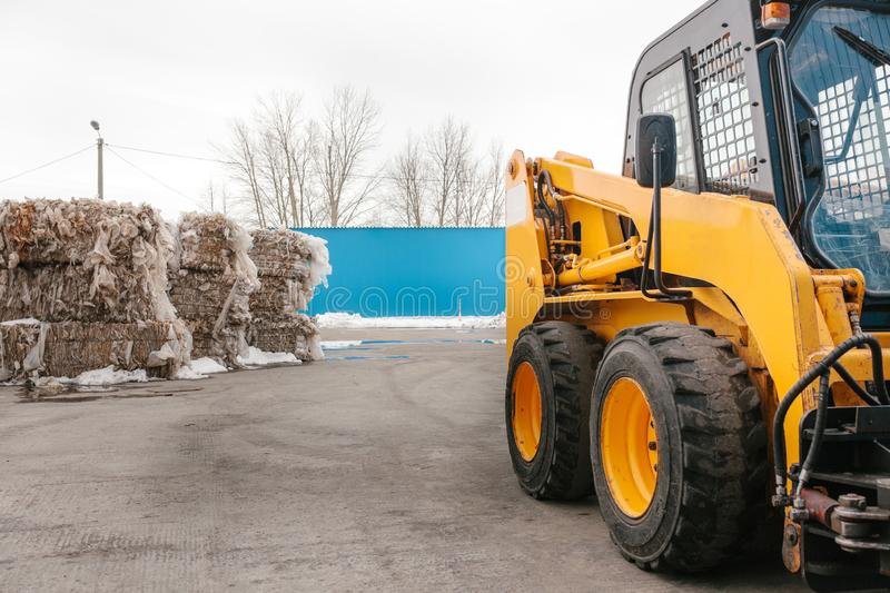Warehousing of garbage and part of a fork-lift truck. stock image
