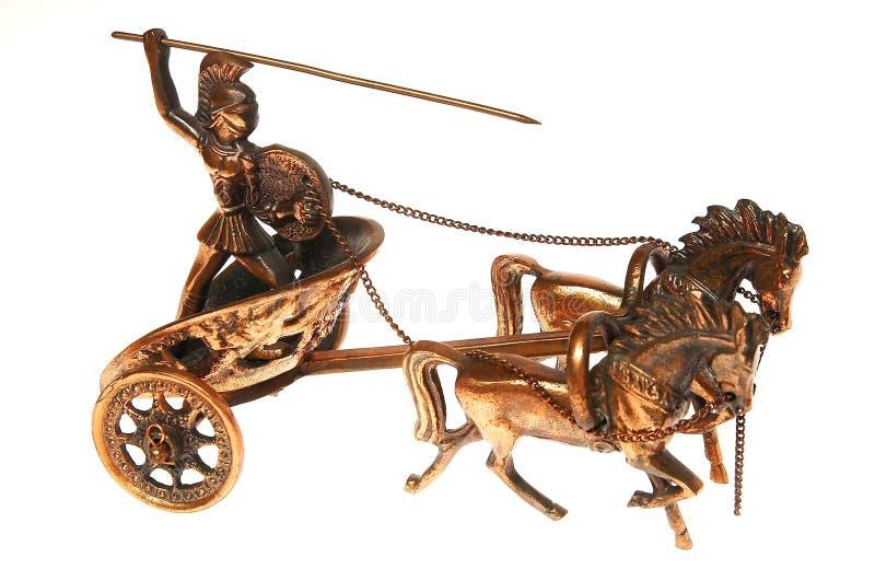 Warior de bronce en carro fotografía de archivo
