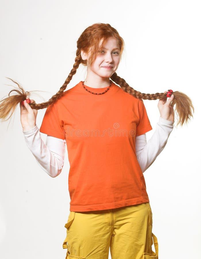 warkocz dziewczyny długa urocza ruda obraz stock