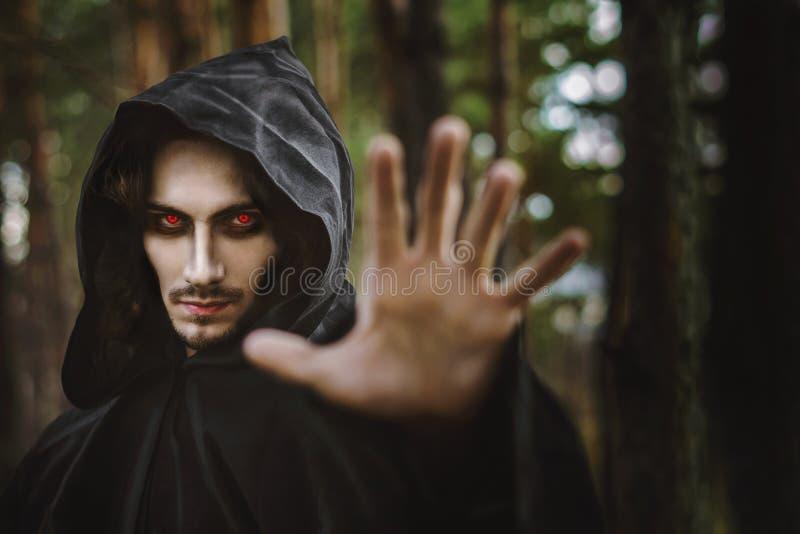 Warlock pointing finger stock photos