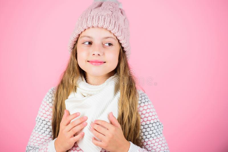 Warm accessories that will keep you cozy winter. Child long hair warm woolen hat enjoy warm and softness. Kid girl wear stock image