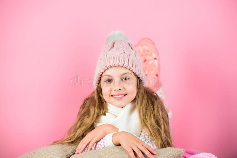 Warm accessories that will keep you cozy this winter. Kid girl wear knitted hat relaxing pink background. Child long. Hair warm woolen hat enjoy warm royalty free stock images