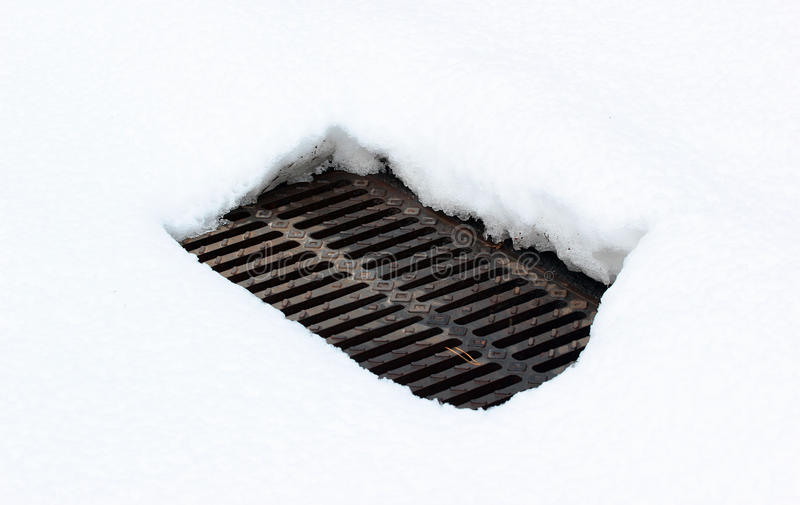 Warm air from a manhole melts snow in winter royalty free stock photos