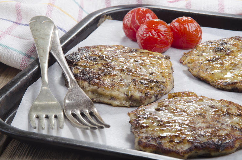 Warm black pudding boxty on a tray royalty free stock photo