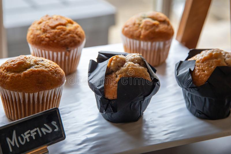 Warm breakfast muffins on display royalty free stock images
