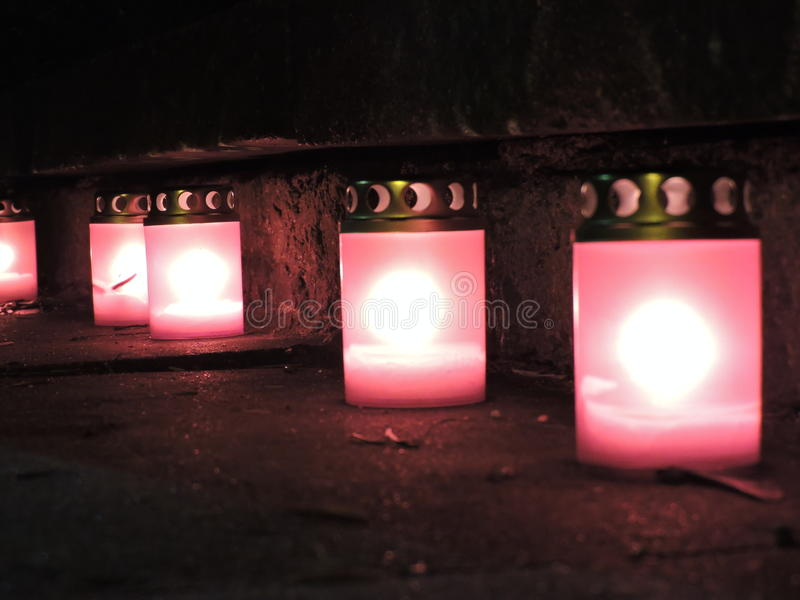 Warm candles in cold day stock photography