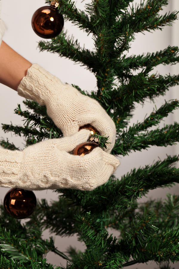 Warm Christmas preparations. Have you tried to decorate fir tree with mitten stock images