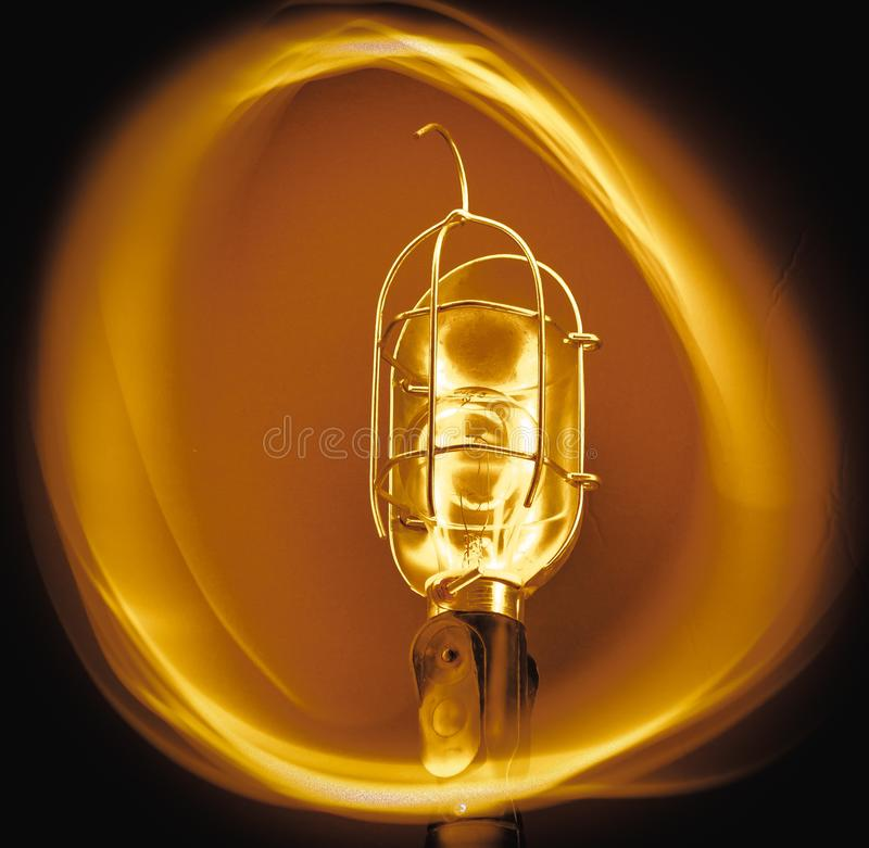 Warm Circle Light Bulb. The image is of a light bulb surrounded by a warm orange light stock photos